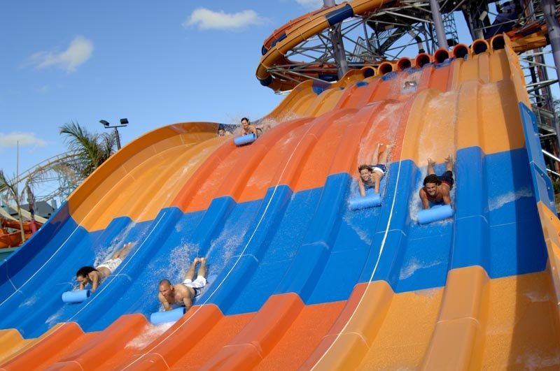 Five people sliding down the Stingray Racer.