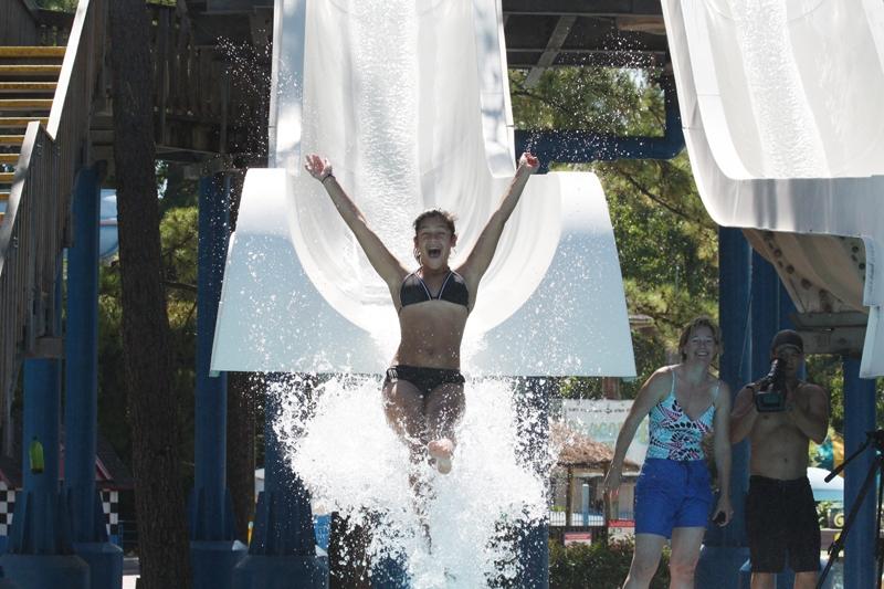 Girl going down water slide