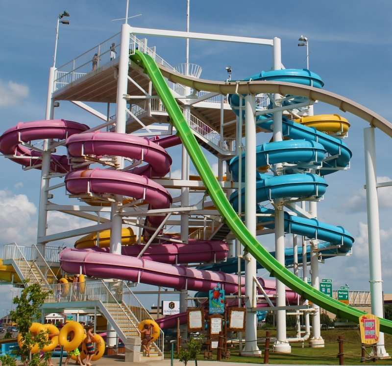 A variety of different waterslides in different colors.