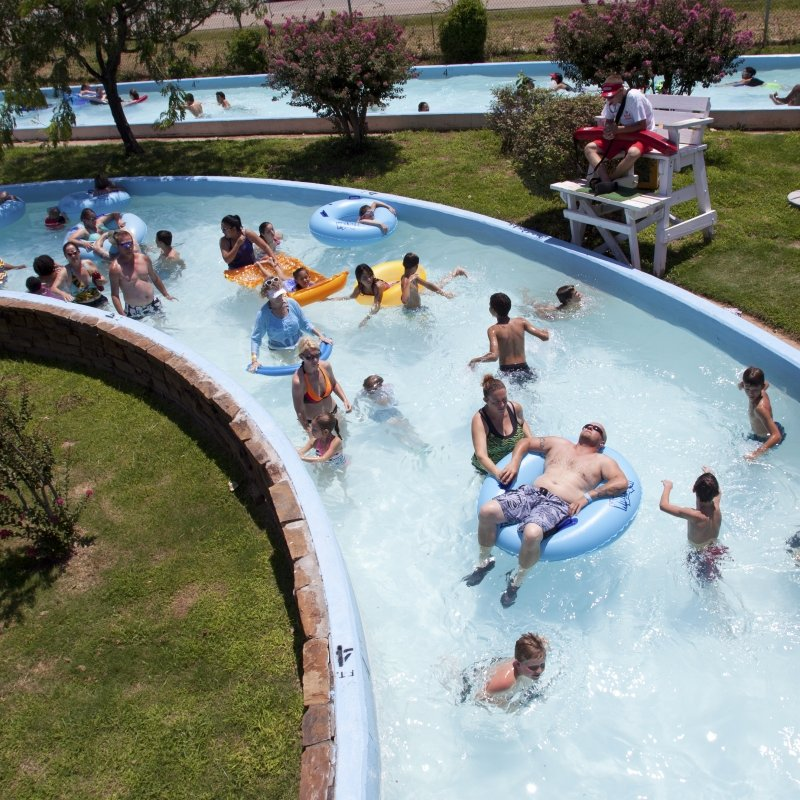 People floating and playing in lazy river.