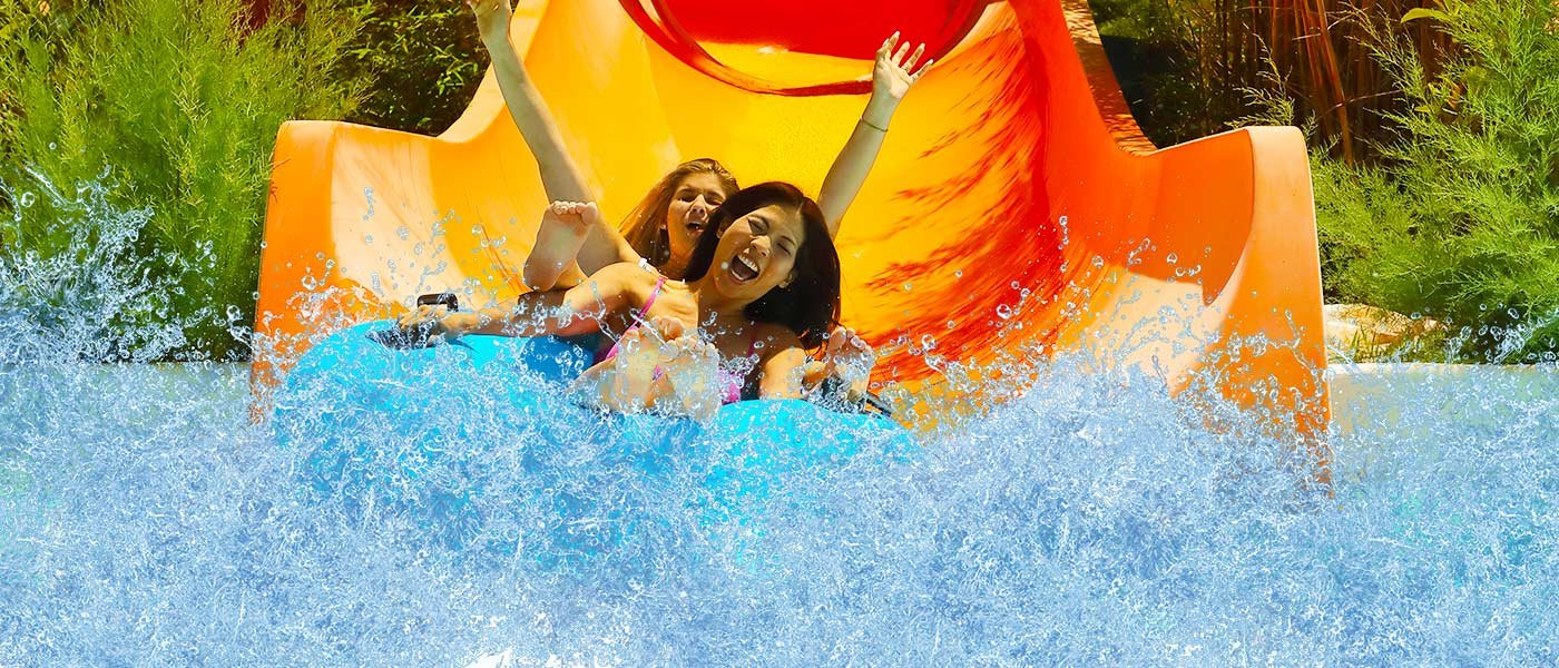 People sliding down a ride at waterpark