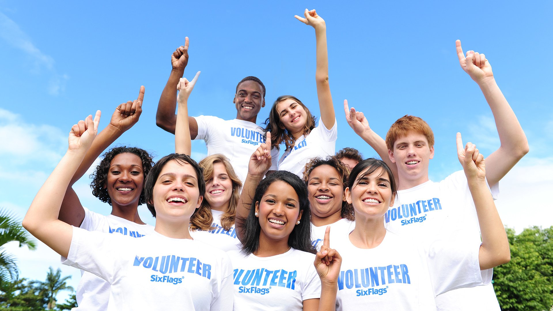 Group of volunteers smiling at the camera at Six Flags theme park
