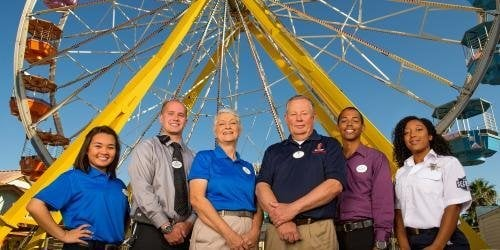 Group of Six Flags employees standing together smiling for picture