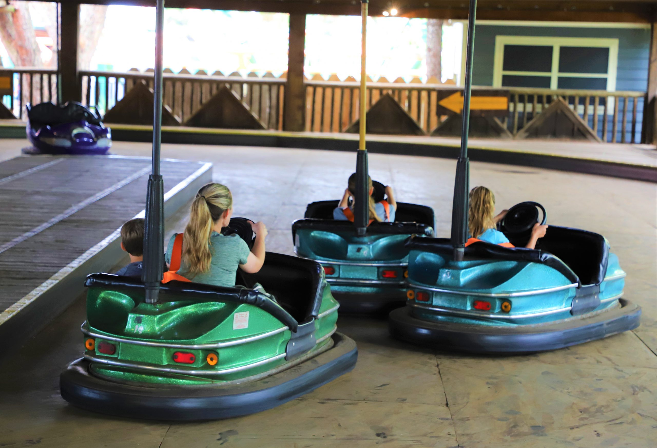 Guests driving bumper cars on Dodge Ems at Six Flags