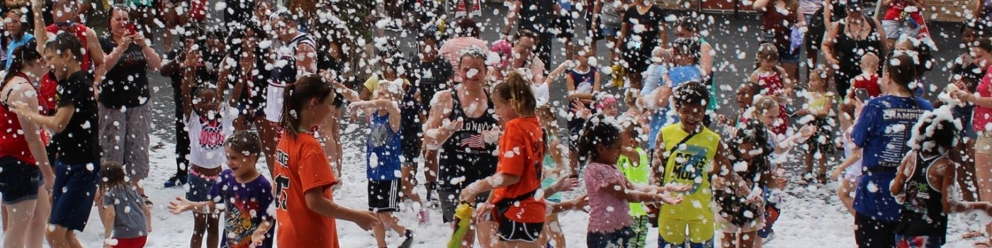 Lots of people covered in foam