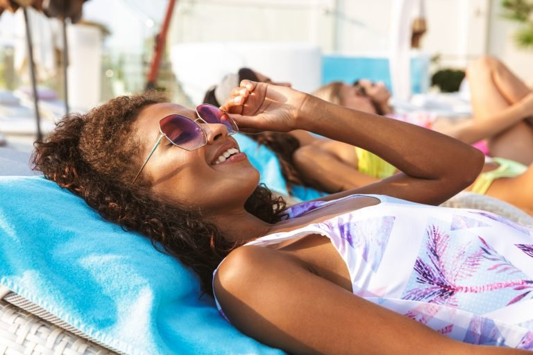 girl-lounging-by-pool-with-sunglasses