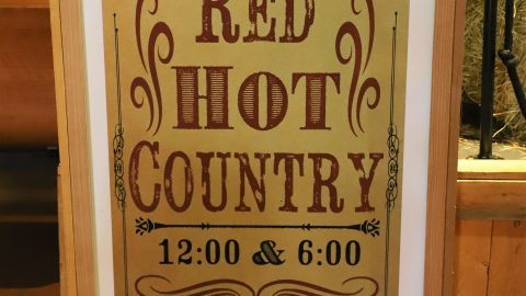 Sign for Red Hot Country with showtimes of 12 and 6