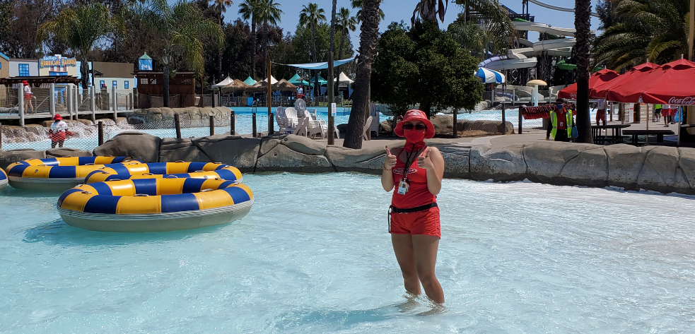 Lifeguard at Hurricane Harbor wearing and mask and giving a thumbs up