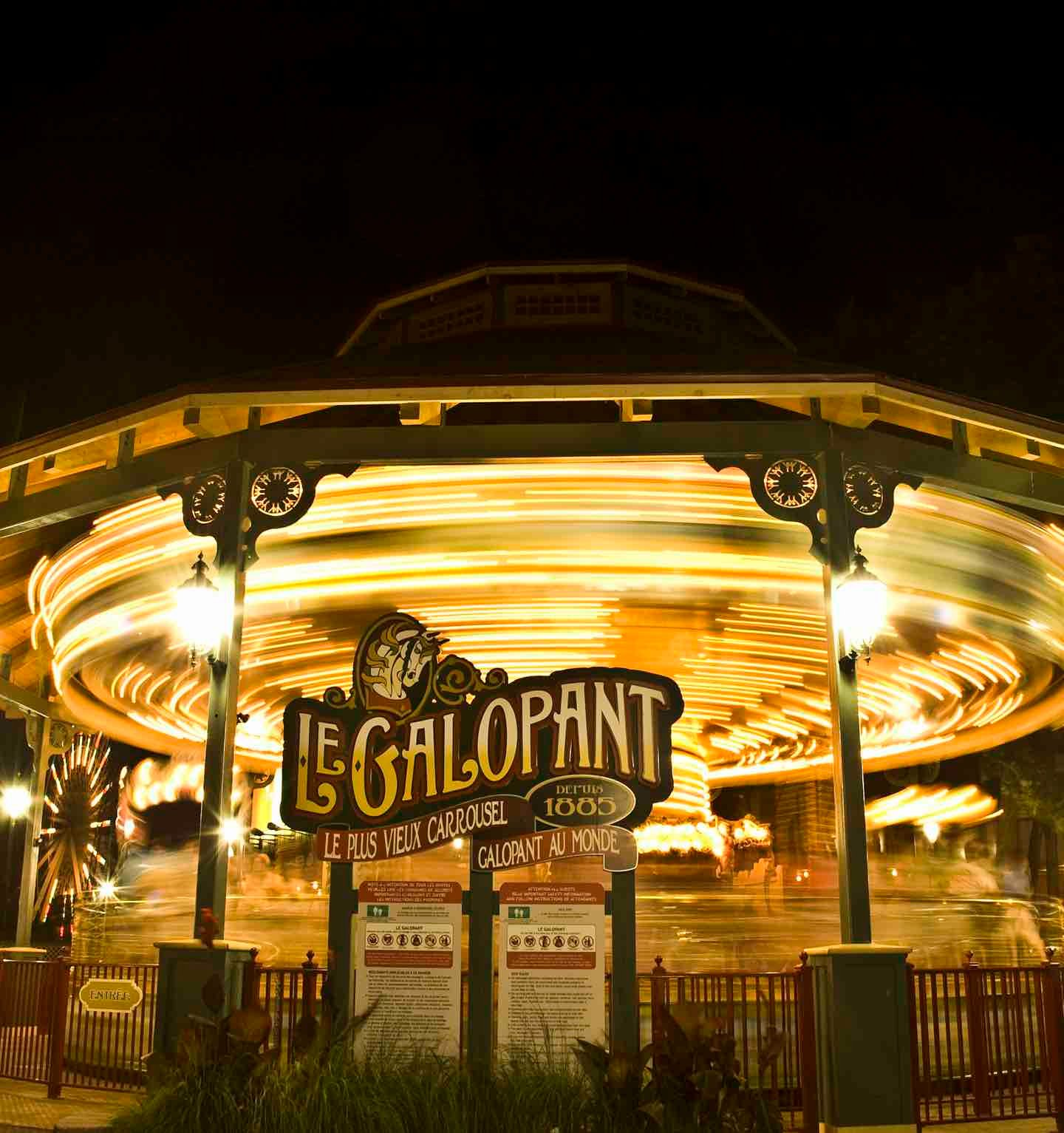 Galopant lit up at night at La Ronde