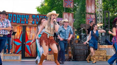 Western Performers on stage for Deep in the Heart at Six Flags