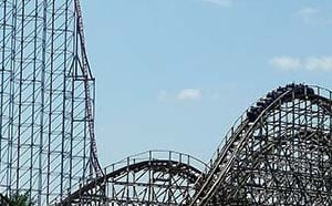 People riding a rollercoaster.