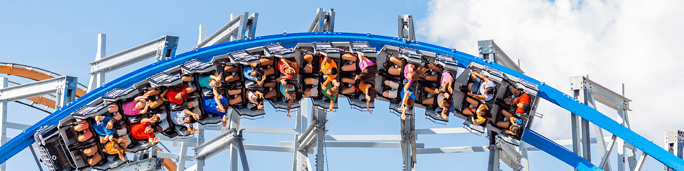 People riding a roller coaster at Six Flags theme park